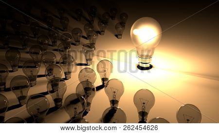 Lightbulbs Placed Around The Glowing Light Bulb. The Big Lighbulb Is Glowing Surounded By Small Ligh