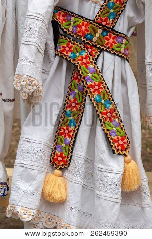 Background With Traditional Dress With Belt Embroidered, Decorated With Specific Patterns Of The Bis