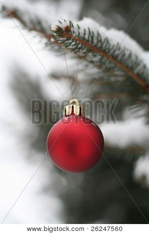 Red Christmas ornament in the snow