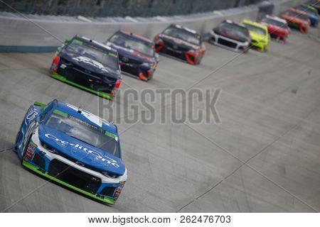 October 07, 2018 - Dover, Delaware, USA: Kyle Larson (42) battles for position during the Gander Outdoors 400 at Dover International Speedway in Dover, Delaware.