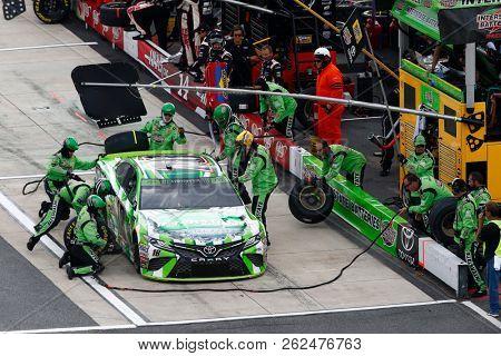 October 07, 2018 - Dover, Delaware, USA: Kyle Busch (18) battles for position during the Gander Outdoors 400 at Dover International Speedway in Dover, Delaware.