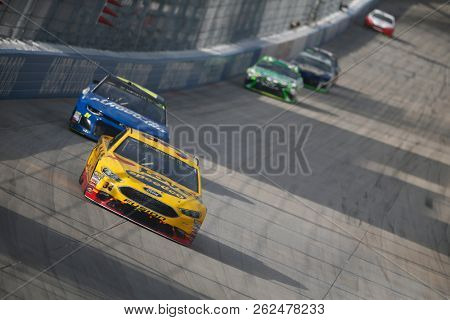 October 07, 2018 - Dover, Delaware, USA: Michael McDowell (34) battles for position during the Gander Outdoors 400 at Dover International Speedway in Dover, Delaware.