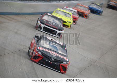 October 07, 2018 - Dover, Delaware, USA: Erik Jones (20) battles for position during the Gander Outdoors 400 at Dover International Speedway in Dover, Delaware.