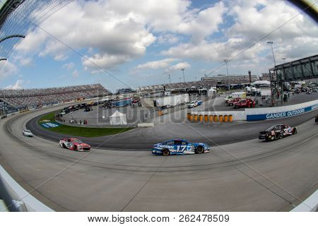 October 07, 2018 - Dover, Delaware, USA: Ricky Stenhouse, Jr (17) races through the field off turn two at  the Gander Outdoors 400 at Dover International Speedway in Dover, Delaware.