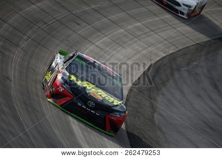 October 07, 2018 - Dover, Delaware, USA: Martin Truex, Jr (78) battles for position during the Gander Outdoors 400 at Dover International Speedway in Dover, Delaware.