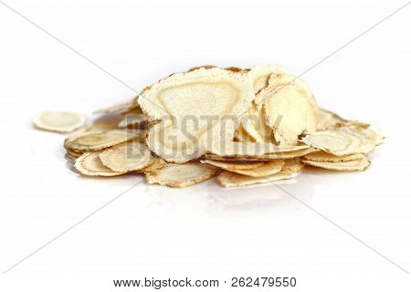 Chinese Herbal Medicine - American Ginseng Slices (panax Quinquefolius) On White Background (manual