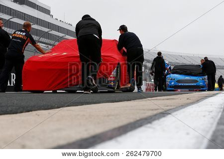October 05, 2018 - Dover, Delaware, USA: Crews push the cars onto pit road to qualify for the Gander Outdoors 400 at Dover International Speedway in Dover, Delaware.