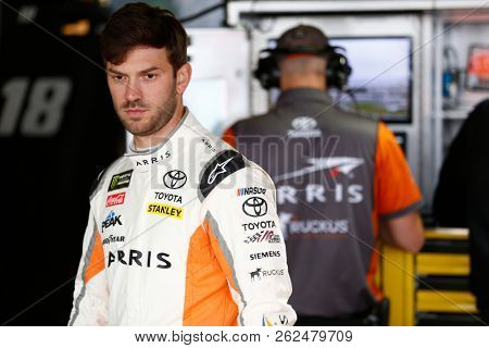 October 05, 2018 - Dover, Delaware, USA: Daniel Suarez (19) hangs out in the garage during practice for the Gander Outdoors 400 at Dover International Speedway in Dover, Delaware.