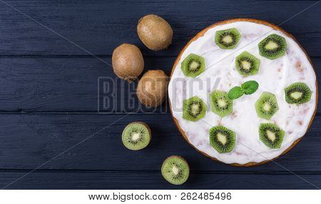 Plate With Homemade Kiwi Cake And Ingredients Viewed From Above