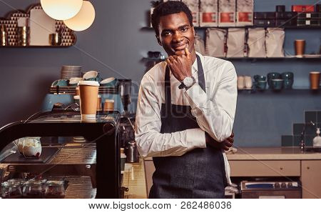 Portrait Of Successful African American Owner Small Business Smiling At Camera While Standing At The