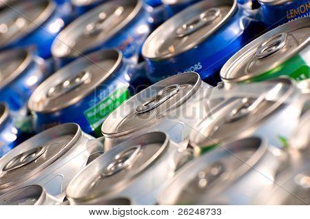 Arrangement of tins of soda.