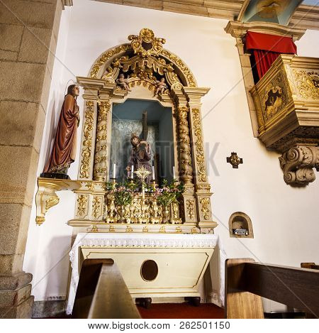 Trancoso, Portugal - June 21, 2018:  View Of Side Chapel With A Beautifully Carved Woodwork Altarpie