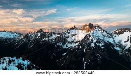 Sunset Illuminates A Beautiful Mountain Panorama. North Cascades National Park, Washington