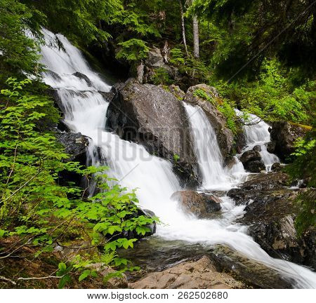 A Waterfall Cascades Over Steep Rocks Near Snoqualmie Pass. Cascade Mountains, Washington.