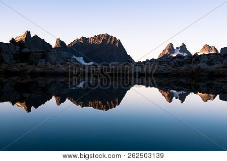 The Dramatic And Icy Peaks Of Summit Chief, Chimney Rock And Overcoat Peak Reflected In The Mirror W