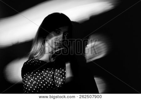 Portrait Of A Woman With Shadows On Face.