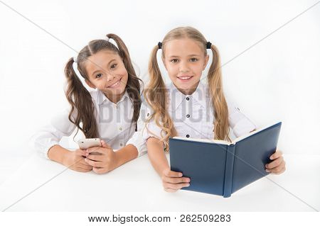 Getting Information. Modern Data Storage Instead Big Paper Book. Little Girls Read Paper Book And Eb