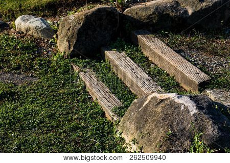 Park Wooden Stairs With Grass And Rocks By Pressure Treated Lumber