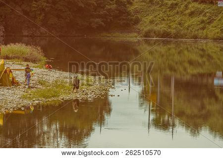 Daejeon, South Korea; September 23, 2018: Unidentified Koreans Camping On Rocky Shore Of River On Fi
