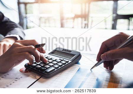 Business Team Analyzing Investment Charts With Calculator Laptop Calculate Technology In Office, Acc