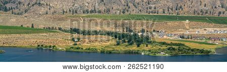 Okanagan Valley Panoramic View With Residential Area And Orchard Farm Fields. Residential Houses In