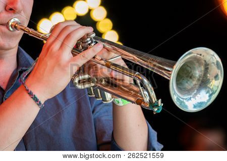 Musician playing trumpet at live concert on the stage