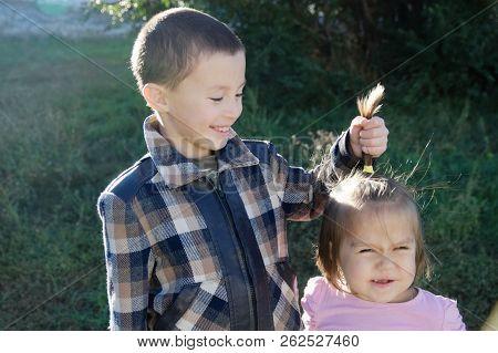 Children Having Fun. Boy And Little Girl Portrait. Happy Smiling Children Outdoors At Sunny Day. Fri