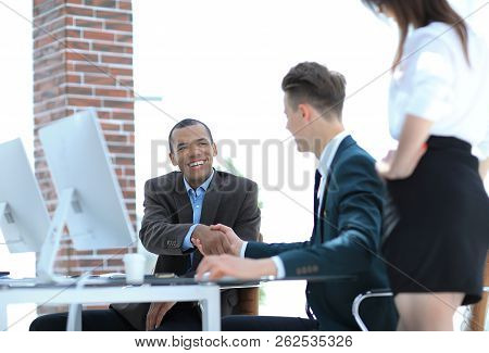 Handshake International Business Partners On A Desk