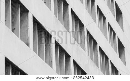 Closeup Ventilated Facade Of Concrete Building. White Ventilation With Creative And Beautiful Patter