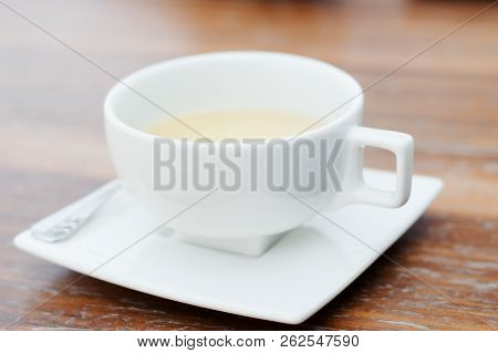 White Cup Of Tea On Wooden Table. Tea Drinking
