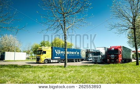 France - May 5, 2016: Man, Daf, Renault Long Haulage Trucks Parked On A Highway Parking Area Of A Fr