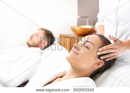 Massage For Couples. A Woman And A Man Together On A Care Treatment In A Spa Salon.