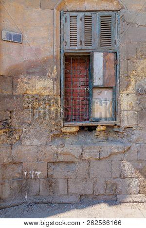 Broken Windows And Grunge Stone Bricks Wall In Abandoned Darb El Labana District, Cairo, Egypt