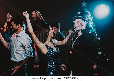 Happy Young People Dancing On New Year Party. Happy New Year. People Have Fun. Indoor Party. Celebra