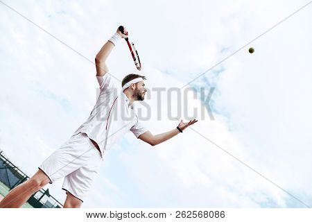 Professional Tennis Player Is Doing A Kick Tennis On A Tennis Court On A Sunny Summer Morning. The I