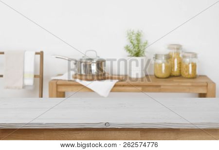 Wooden Table Top With Blurred Kitchen Background For Product Display
