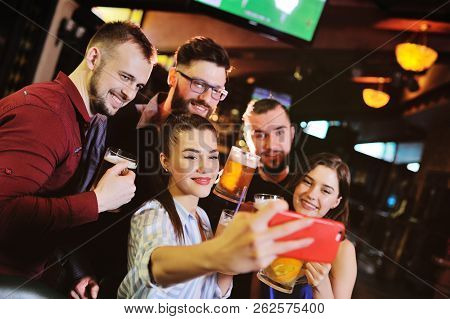 Young People - Friends Drink Beer, Eat Pizza, Talk And Laugh And Shoot Selfie On The Smartphone's Ca
