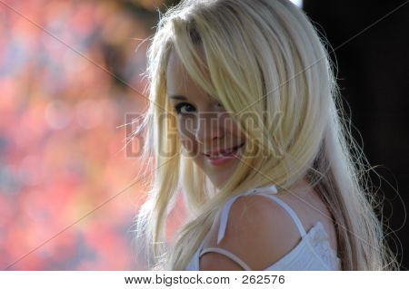 gorgeous young woman with a blurred pink nature background