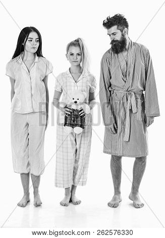 Man With Beard, Cute Blonde And Brunette Girls With Toy Bear Just Wake Up In Morning. Sleepy Morning