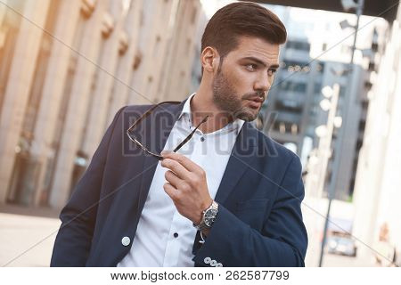 Sexy Stylish Man With Sunglasses. City Style. A Beautiful And Charming Man With Sunglasses Outdoors.