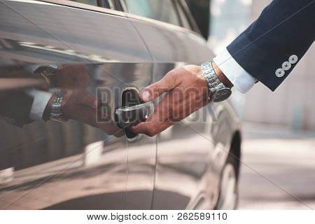 Hand On Handle. Close-up Of Man Hand Opening A Car Door.