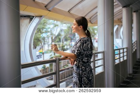 Woman Holding A Cup Of Coffee In Center City,happy And Smiling,outdoor Lifestyle,female With Positiv