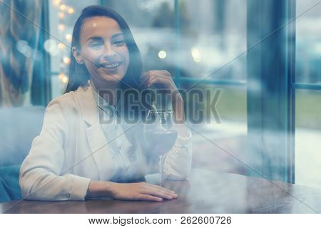 Happy Female Person Enjoying Bocal Of Red Wine