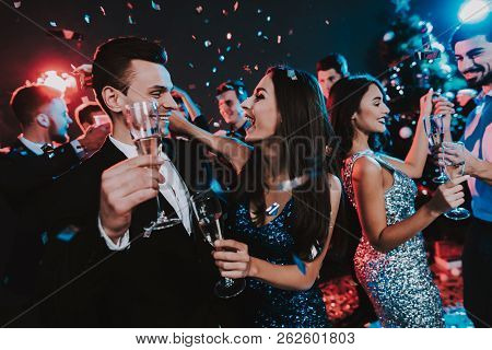 Happy Young People Dancing On New Year Party. Happy New Year Concept. Glass Of Champagne. Celebratin