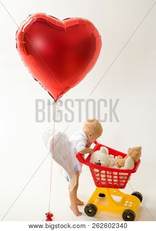 Little Boy Go Shopping With Full Cart. Little Boy Child In Toy Shop. Valentines Day And Love. Shoppi