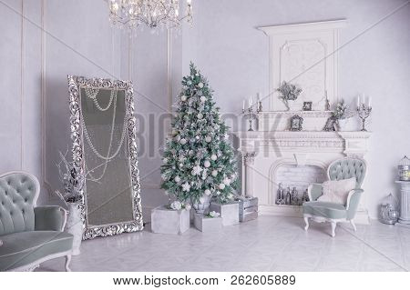 Decorated Christmas Tree And Gift Boxes In Living Room.large White Living Room With A Vintage Furnit