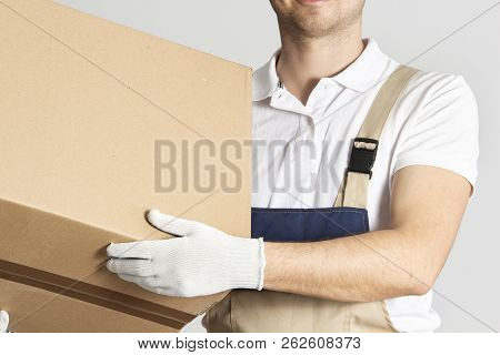 Free Shipping. Delivery Man With Cardboard Box In Hands. Parcel.