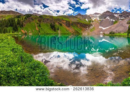 Blue Lake Near Near Ridgway Colorado With Mountain Sneffels, Dallas Peak And Gilpin Peak In The Back