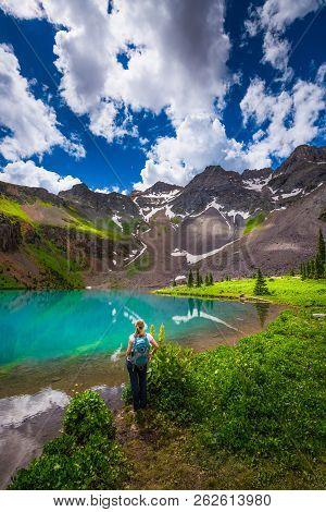 Hiker Looks At Blue Lake Ridgway Colorado