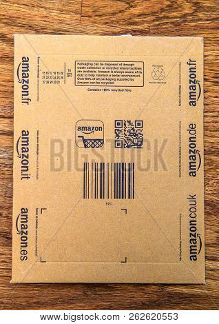 Pparis, France - Jun 21, 2018: Directly Above View Of Amazon Parcel Cardboard On Wooden Background